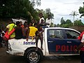 Haitian police saving people from flooded waters.jpg