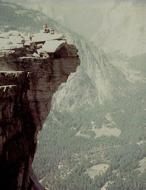 Half Dome - Climbers on The Visor atop Half Dome, looking down (west) into Yosemite Valley.