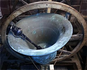 Church bell - English style full circle bell with clapper half-muffled. A leather muffle is put over one side only of the clapper ball. This gives a loud strike, then a muffled strike alternately.