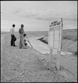 Heart Mountain Relocation Center, Heart Mountain, Wyoming. A group of center residents watch from t . . . - NARA - 539404.tif