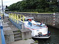 Heumen(Gld, NL) canal lock Maaswaalkanaal with Barge.JPG
