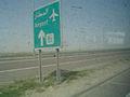 Highway sign, road to Kuwait International Airport.JPG