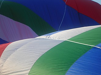 Color constancy - Color constancy: The colors of a hot air balloon are recognized as being the same in sun and shade