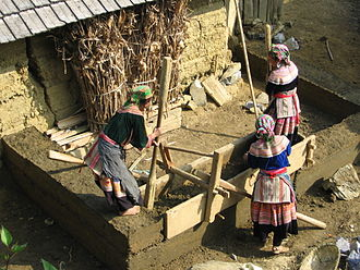 Hmong people - A typical rammed earth house building technique of flower Hmong in Vietnam.