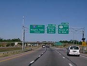 Helvetica signage for exit 18A on I-190