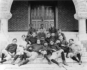 A group of boys seated on stairs