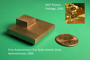 Chip-scale atomic clock - Early Chip Scale Atomic Clocks from NIST (upper right: prototype) and Symmetricom (lower left: first autonomous Chip Scale Atomic Clock).