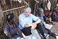 International Development Secretary Andrew Mitchell talks to beneficaries of a UK-funded food security project on a visit to Karamoja, Uganda, September, 2011 (6309751874).jpg