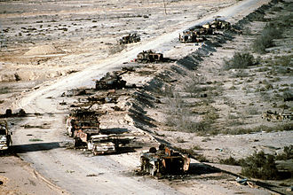 Battle of Rumaila - Aerial view of a destroyed Iraqi column consisting of a T-72 tank, several BMP-1 and Type 63 armored vehicles, and trucks on Highway 8 destroyed at the Battle of Rumaila, March 1991.
