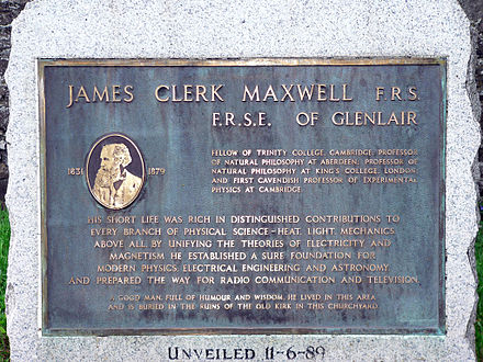 This memorial stone to James Clerk Maxwell stands on a green in front of the church, beside the war memorial at Parton (Galloway). JCM Memorial Stone-1.jpg