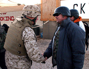 Jim McMahon - McMahon being greeted by the Commanding Officer of the 15th MEU during his USO tour in Iraq in December 2006.