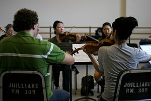 Music lesson - Juilliard School of Music Chamber Orchestra. While lessons are often individual (one teacher and one student), group lessons or coaching sessions are also done.