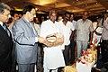 Kavuru Sambasiva Rao going round the exhibition at the International Seminar for Promotion of Exports of Indian Handicrafts & International Craft Exchange Programme, in New Delhi on September 18, 2013 (1).jpg