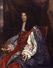 Painting of seated male figure, with long black hair wearing the white cape and breeches.