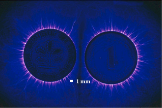 Kirlian photography - Kirlian photograph of two coins