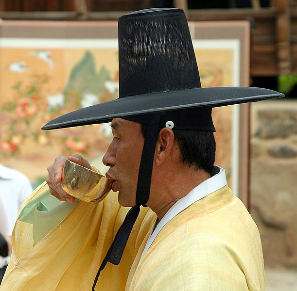 File:Korea-Andong-Hahoe Folk Village-Man in hanbok drinking-01.jpg