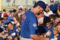 Kris Bryant signing autographs during his rehab assignment against Omaha (43598156154).jpg