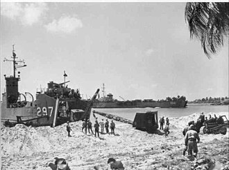 USS Montgomery County (LST-1041) - USS LSM-297 and LST-1041 beached while unloading equipment, date and place unknown.