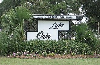 """Lake Terrace/Lake Oaks, New Orleans - Lake Oaks sign on Elysian Fields Avenue. Note the """"Developed by Orleans Levee Board"""" heading."""