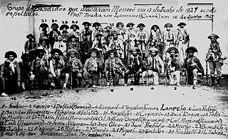 Cangaço - Lampião's band, plus 4 prisoners (taken to extort ransoms), photographed in Limoeiro soon after their attack on the town of Mossoró in 1927 - 27 bandits are in the photo, but the band numbered around 60 men at the time