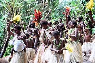 Land diving - People below dance and sing chants, providing emotional support for the divers.