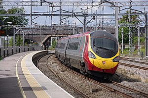 InterCity West Coast - Virgin Trains Class 390 ''Pendolino'' passing through Lichfield Trent Valley in August 2011