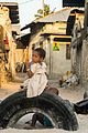 Little girl on a tire.jpg