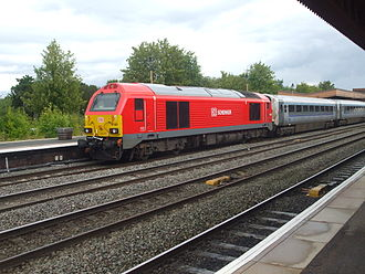 Rail transport in Great Britain - A Deutsche Bahn train at Leamington Spa hauled by a Class 67, under DB Cargo UK, with Mark 3 carriages in Chiltern Railways livery.