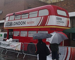 BBC Local Radio - A Routemaster double-decker bus, being used as a mobile radio broadcasting facility by BBC Radio London in 2011.  Note its former title; previously known as BBC London 94.9 FM from late 2001 to 2015.