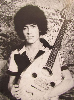 Algerian mandole - Lounès Matoub in 1975 with an Algerian mandole. His mandole has oval and not the characteristic diamond sound hole.