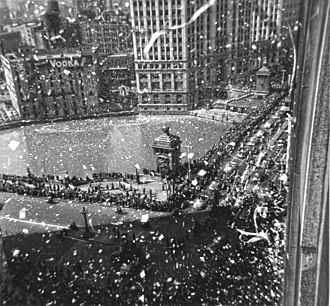 A euphoric ticker-tape parade for MacArthur took place in Chicago on 26 April 1951. MacArthur is in the second car. MacArthur parade in Chicago April 26,1951.jpg
