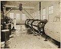 Man operating machinery in Supply Laundry Company, Seattle, 1917 (MOHAI 4673).jpg