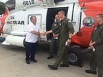 Man rescued by Coast Guard reunited with rescue crew 140729-G-EP136-001.jpg