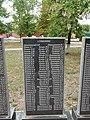 Mass grave of Soviet soldiers and memorial sign to compatriots in Shevchenkove settlement, Kharkiv Oblast by Venzz 26.jpg