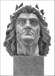 The head of a long-haired man wearing a laurel wreath