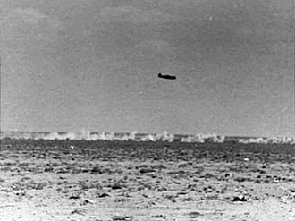 Strafing - Messerschmitt Bf 109E strafing Australian positions in North Africa, 1941