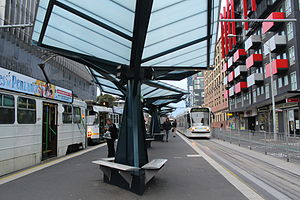 Melbourne University tram stop, looking north, 2013 (1).JPG