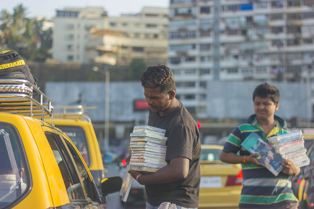 Men selling goods at a traffic signal in Mumbai