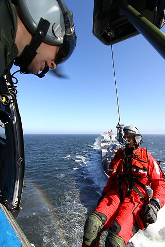 751 Squadron (Portugal) - Photography: Menso Van Westrhenen. Search and Rescue training flight with a merchant marine ship.