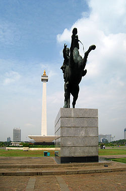 National Monument stands in the middle of Merdeka Square, and Prince Diponegoro statue on the foreground, Jakarta