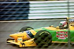 Michael Schumacher - Benetton B193B heads for Copse during practice for the 1992 British Grand Prix (32873469663).jpg