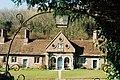 Milton Abbey, almshouses through churchyard gate - geograph.org.uk - 518601.jpg