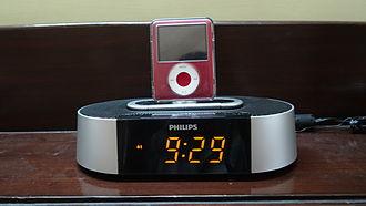 Alarm clock - A modern clock radio features a radio/iPod/buzzer as alarms.