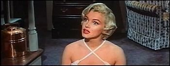 Marilyn Monroe listening in the theatrical tra...