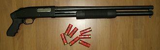 Pump action - A Mossberg 500 12-gauge pump-action shotgun with a pistol grip.