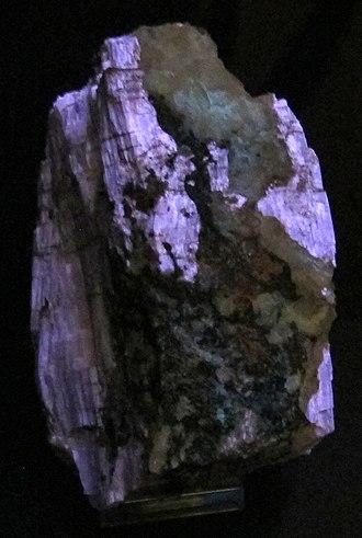 Agrellite - Agrellite showing fluorescence in ultraviolet light