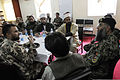Muslim scholars serving with a Jordanian Engagement Team, center, listen as a counterpart speaks with members of the Afghan National Army's 201st Corps at Forward Operating Base Gamberi in Laghman province 130424-A-UO630-010.jpg