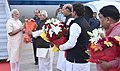 Narendra Modi being received by the Governor of Uttar Pradesh, Shri Ram Naik, the Union Home Minister, Shri Rajnath Singh and the Chief Minister of Uttar Pradesh, Shri Akhilesh Yadav, on his arrival, at Lucknow.jpg