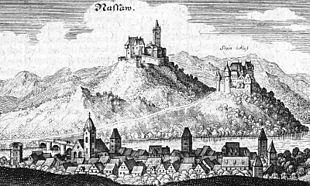 Die Stadt Nassau mit der fürstlichen Burg Nassau und der Stammburg der Familie vom Stein (Stein'sche Burg) unterhalb (Merian 1655). Nach dem Verfall der Burg zog die Familie in einen mit der Zeit ausgebauten Zehnthof in den Ort Nassau, das Stein'sche Stadtschloss. (Quelle: Wikimedia)