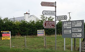 Regional road (Ireland) - The R348 near Woodlawn, Co. Galway, with a mixture of fingerpost and improved signposts